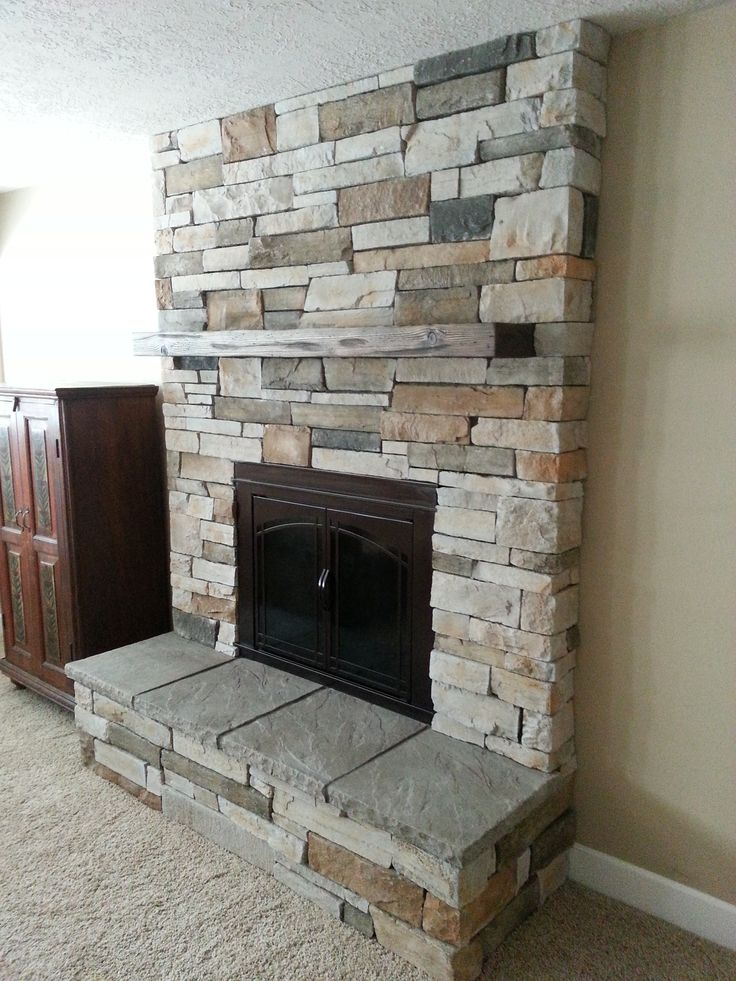 fireplace remodel, cultured stone, new insert, raised