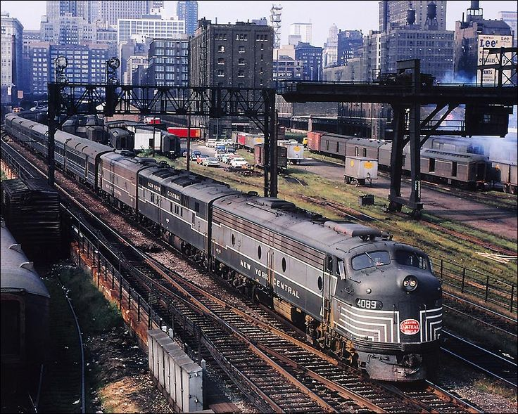 """abuserfriendly: """" marmarinou: """" New York Central Railroad #4089 E-8 and E-7A pulling New England States at La Salle Street Station in Chicago in 1961. Dan Pope Collection """" In less than 10 years it would be down to a single coach… """""""