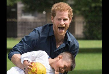 Try Not to Smile While Looking Through All These Adorable Photos of Prince Harry With Kids, Dogs and His Family