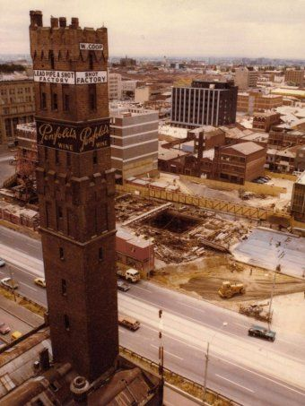 Lonsdale St View of construction in central Melbourne 1975 of underground city loop rail. Now Melbourne Central. An aerial view of a shot tower looking over a construction site.