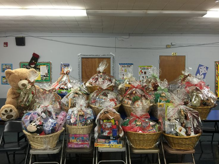 Get your tickets for the basket raffle at the St. James Christmas Fair!  The Ticket Prices are 1 for $1, 6 for $5 and 13 for $10. Themes include: Backyard Fun, Baker's Delight, Christmas Wonderland, Family Night In, Coffee & Tea Lovers, Disney Fun, A Taste of Italy, Autumn Harvest, Through the Grapevine, It's a Wrap and a Giant Stuffed Teddy Bear.