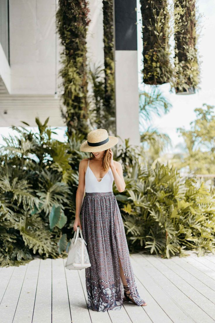 White bodysuit + bohemian maxi skirt = warm weather style perfection. Click to see the look!
