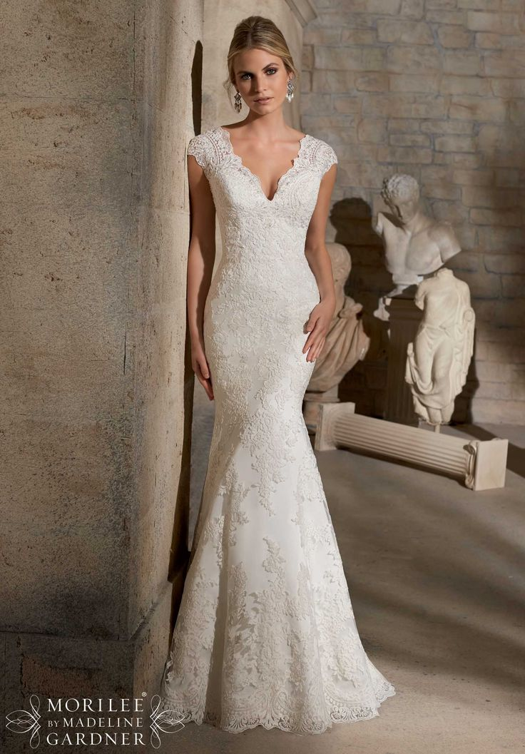 Wedding Gowns by Morilee featuring Embroidered Appliques on Net with Crystal Beading and Wide Hemline- Available in Three Lengths: 55 inches, 58 inches, 61 inches Available in White, Ivory