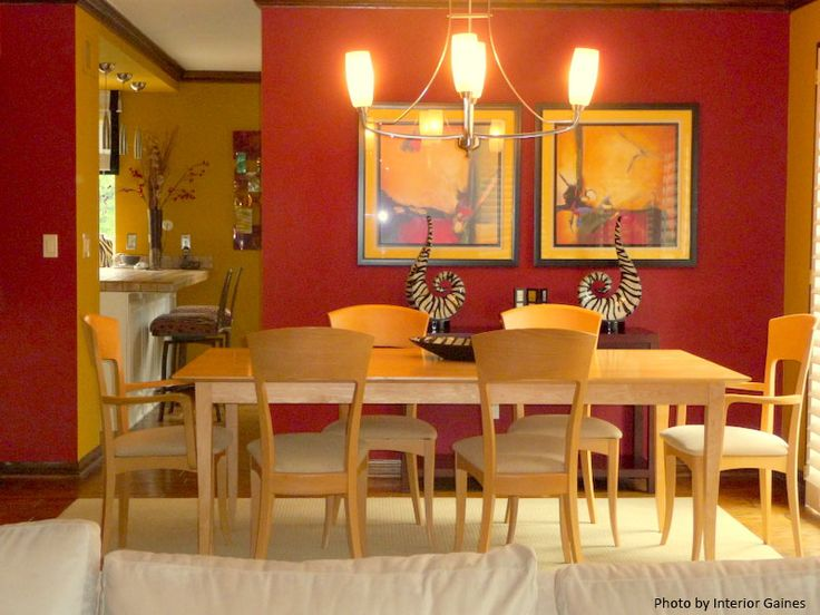 A beautiful modern dining room with red accent wall light for Beautiful modern dining rooms