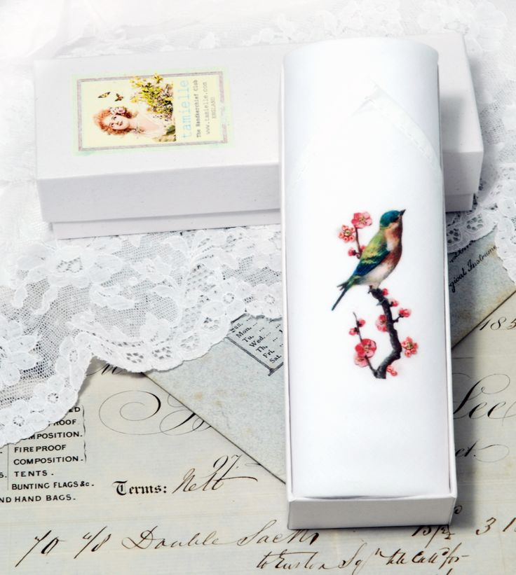 An image of a bird on a cherry tree blossom is printed on this cotton handkerchief. Then some of the flowers are hand embroidered on it. The same way handkerchiefs were made many years ago: With colourful threads, a needle and LOTS of patience and LOVE.