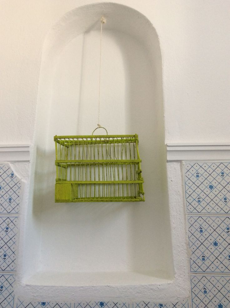 tiny cages decorating the niches in the BLUELIFE bathrooms