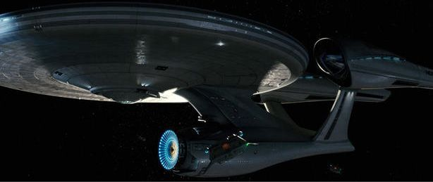 """A still from the  film """"Star Trek"""" (2009) showing the reimagined U.S.S. Enterprise (still NCC-1701), which exists in an altered reality."""