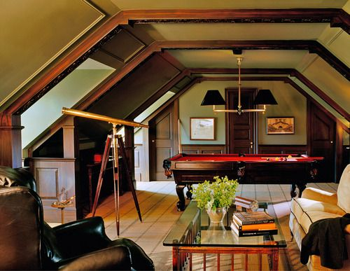 Tailored yet cozy attic game room and den built right into the...