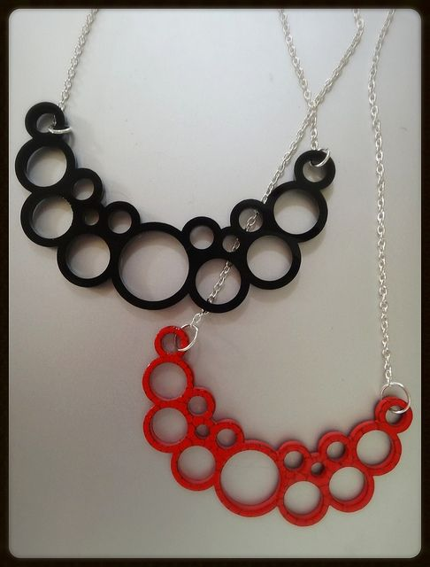 Pipe Necklaces - Black and Red laser cut acrylic on iron coated chains. Original designs inspired by industrial pipes and 60s pop art.