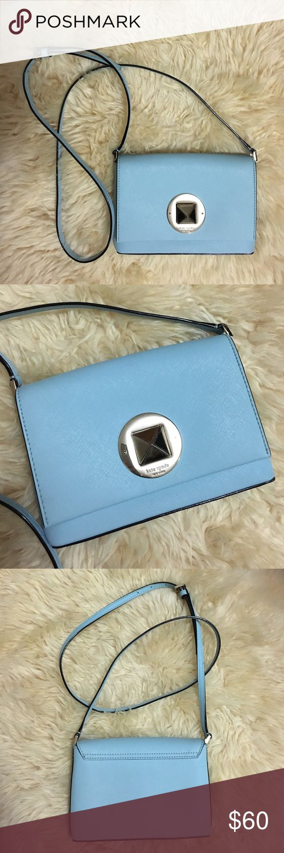 """Kate Spade New York Newbury Lane Sally Crossbody Kate Spade New York Newbury Lane Sally Crossbody in Blue Hydrangea. Features Saffiano leather with 14-karat light gold plated hardware 7.5"""" W x 5"""" H x 1"""" D  Crossbody strap with 21"""" drop Turnlock closure Interior features slip pocket. Scratches on lock but leather is in great condition. kate spade Bags Crossbody Bags"""