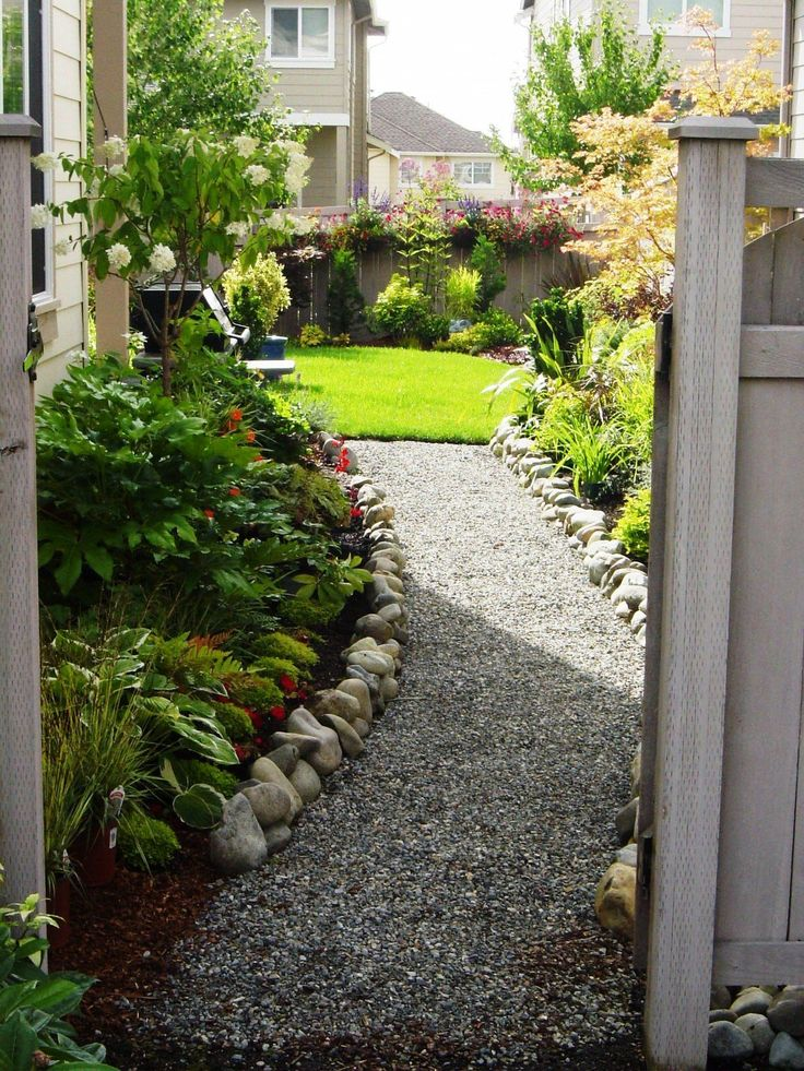 pretty walkway into a beautiful backyard