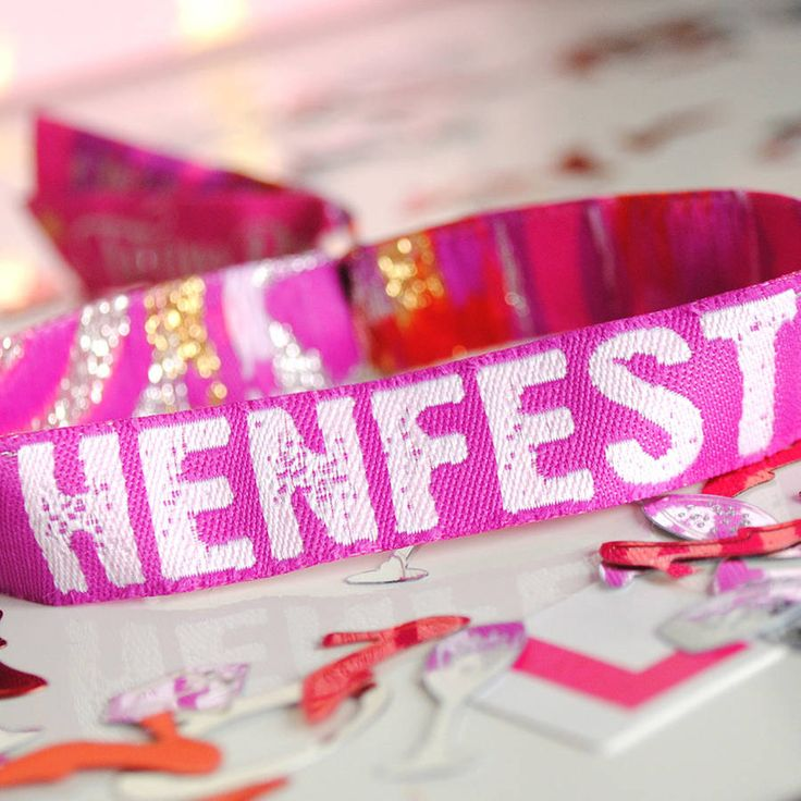 If you are a Festival Bride or having a festival style Hen Party then these HENFEST Hen Party wristbands need to be in your lifeThe awesome Henfest Hen Party Wristbands are the perfect accessory for all your Hen's to wear on your Hen Night or weekend away. These fabric wristbands are exactly like the ones you would get at any major music festival and are perfect keepsake for all your friends and family once the party weekend is over. These wristbands have the text HENFEST on the main part of…