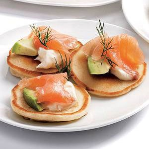 Salmon & Avocado Blinis are an easy way to add elegance to your party | http://www.rachaelraymag.com/Recipes/rachael-ray-magazine-recipe-search/breakfast-brunch-recipes/salmon---avocado-blinis