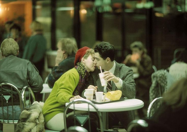 MOSCOW. Eating at McDonalds fastfood, a popular place for young Russians. Gueorgui Pinkhassov. This is a intimate image in a public place, I like the way the photo is voyaristic, therefore very natural.