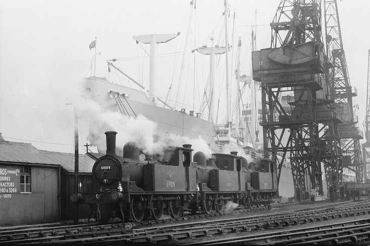 Scenes within Middlesbrough Docks are almost non-existent and this one was taken just a few weeks before steam shunters there were replaced by diesels. On 9th January 1962 Nos 69019, 69017 and 68754 are seen ready for action alongside ships berthed at the quay.