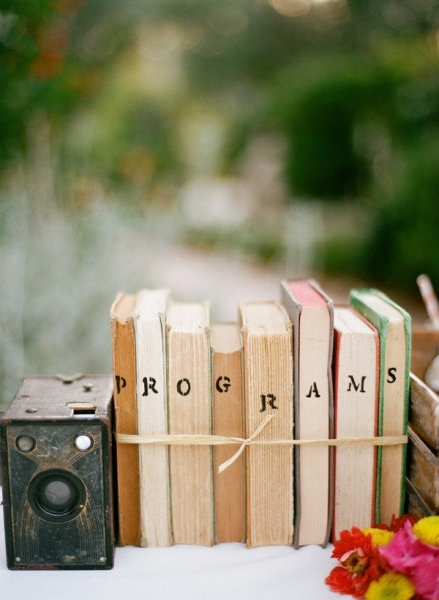 """Like the idea of making a label for a """"zone"""" within the wedding by putting it on the books and tying them with twine"""
