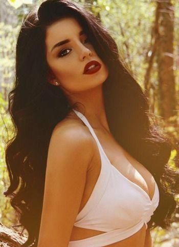 Dark hair, vampy makeup