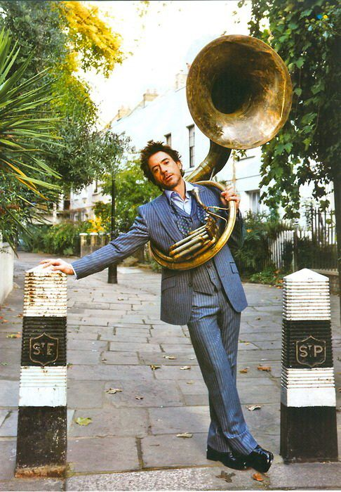The world needs more RDJ holding a sousaphone.