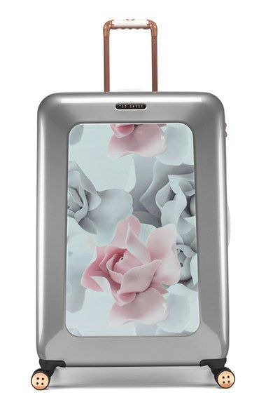 Free shipping and returns on Ted Baker London 'Large Porcelain Rose' Four Wheel Suitcase (31 Inch) at Nordstrom.com. A lightweight suitcase designed with four smooth-rolling 360-degree wheels for easy concourse navigation is made from aircraft-grade aluminum and tough-as-nails polycarbonate to help it withstand the rigors of travel. A lovely floral print and rose-goldtone hardware ensure it stands out from the crowd at baggage claim.