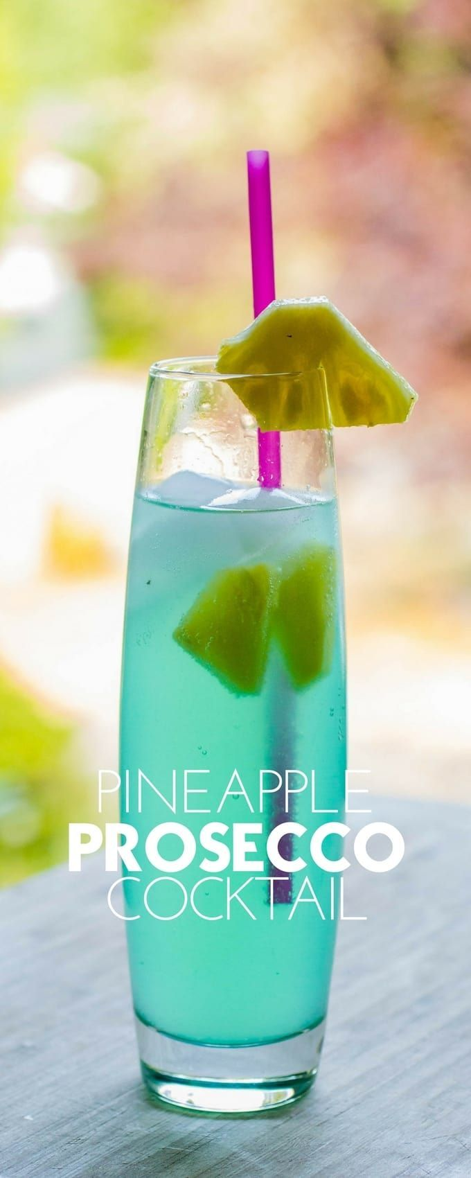 This pineapple prosecco cocktail is like your favorite mimosa fell in love with a pineapple, and a shot of the ever-classy Kinky Blue Liqueur.