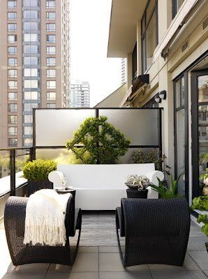 Comfy, modern patio.. Minus the city background