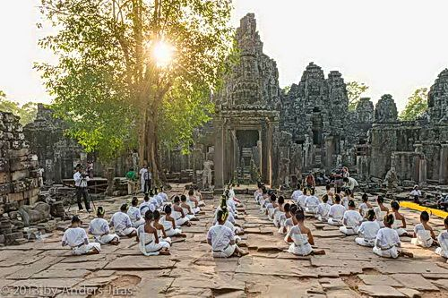 SIEM REAP, CAMBODIA – Bayon temple lit up with 1,250 candles as fifty dancers from the Conservatoire NKFC Preah Ream Buppha Devi took part in a Buong Suong sacred dance ritual to commemorate Meak Bochea Day, one of the holiest days on the Buddhist calendar.