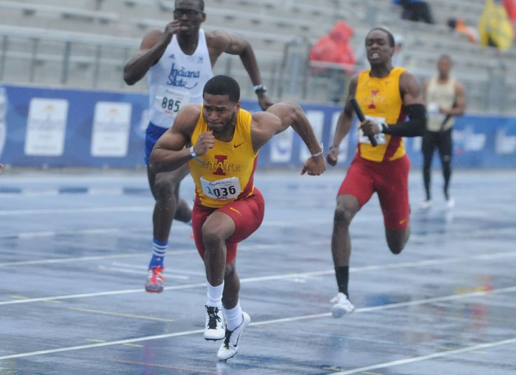 Iowa State's Jomal Wiltz, left, and Ben Kelly prepare to exchange the baton during the university men's 4x100-meter relay at the Drake Relays on Friday at Drake Stadium in Des Moines. Photo by Nirmalendu Majumdar/Ames Tribune http://www.amestrib.com/sports/drake-relays-isu-s-luque-takes-second-long-jump