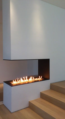 Houzz- custom. Love the fireplace. It would look great with something over it!