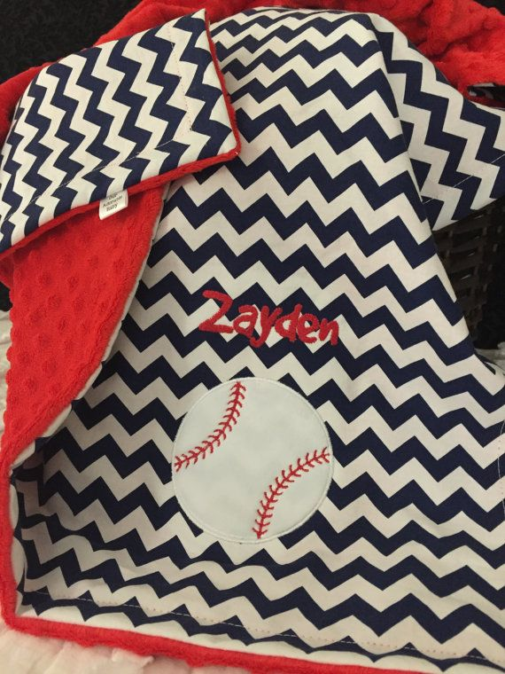 Baby Blanket is made using a gray, light pink, or navy blue cotton chevron on one side and your choice bubble dot on the other. The front side features babys name in the same color you selected for the backing and a baseball. Your baby (and any baseball lover!) is sure to love this blanket!!  Please include the following in the Note to Seller section when you check out: 1) Name 2) Font Choice *Shown in Childs Handwriting and will be used if no font choice is noted  Finished blanket measures…