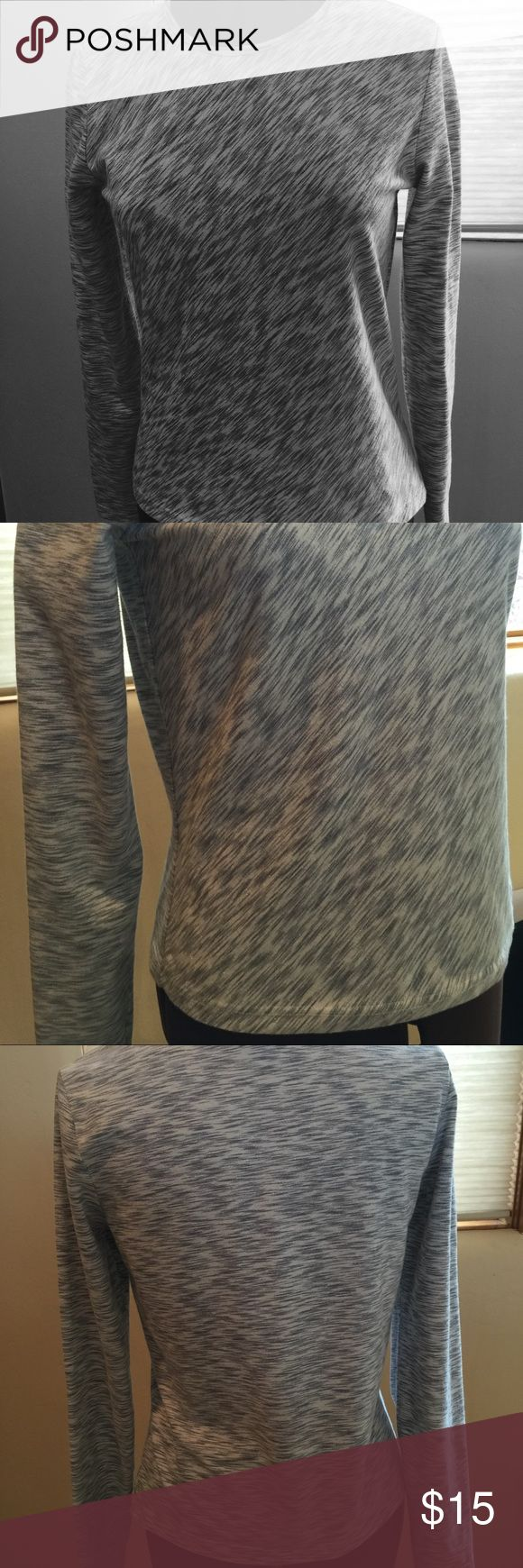 GAP Stretch Long Sleeve Shirt Silver and white with some shimmer, this long sleeve stretch shirt from GAP is the perfect 'pair with anything' top. 8% spandex for perfect shape and hold. Size Medium. GAP Tops Tees - Long Sleeve