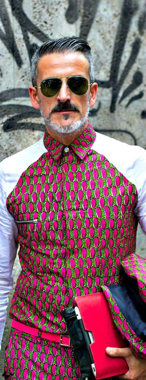 Not for the faint of heart. This mens street style calls out bright bold print with solid sleeves. follow pinterest.com/shefoxinvites for more fashion and lifestyle