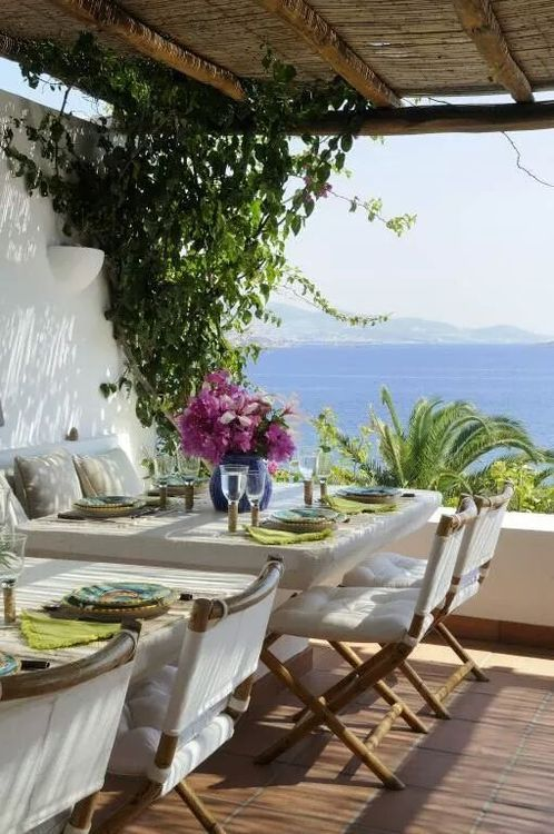 A breakfast in a beautiful home by the sea, the weather is warm and sunny. A peaceful and harmonious morning.