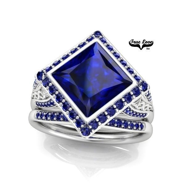 Lab created blue sapphires set in 14kt white gold. Shown with matching band.   Want to make changes to this style, or design your own ring? Ask us how!