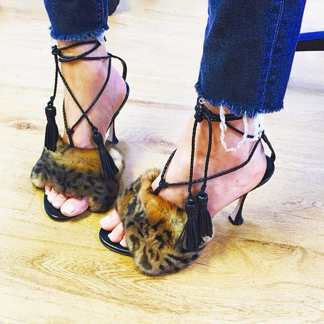 """""""One of a kind pair of shoes from #FashionMaker @Liudmilahq from Italy. This women's Luxury footwear brand gives an inspiration to women who desire to live a life of sensory beauty. The soft leopard furs on top of the foot and those black tassel stripes which wraps the ankles are absolutely chic."""
