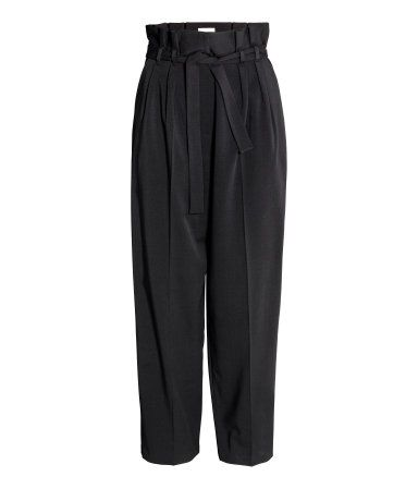 Black. Pants in woven crêped fabric. Pleats at front and removable tie belt at waist. Side pockets, zip fly with hook-and-eye fastener, dropped gusset, and