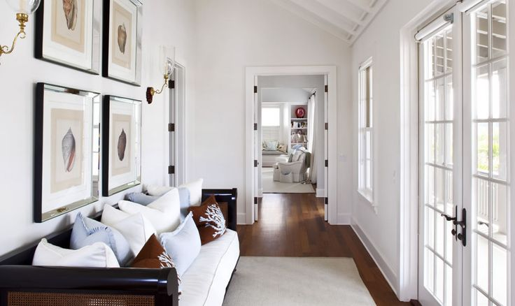Love the white walls and the light in this room