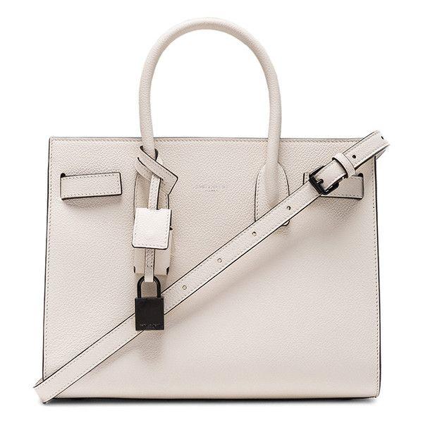Saint Laurent Baby Sac de Jour (£2,086) ❤ liked on Polyvore featuring bags, handbags, pocket bag, man bag, pink bag, hardware bag and yves saint laurent bags