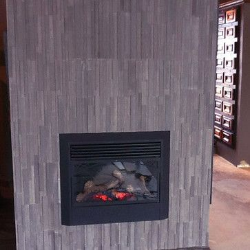 Really contemporary look with the tiles going vertical. Would make the fireplace seem tall but thinner and would seem not to be taking up much space.