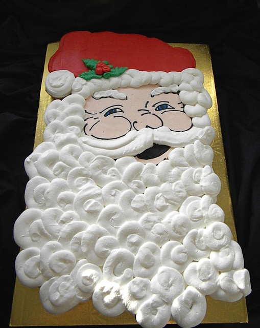 I wanna make this for Leia's school next year! It'll be enough for both classes!! Large Santa shaped cupcake cake 59 cupcakes by Giggy's Cakes and Sweets, via Flickr