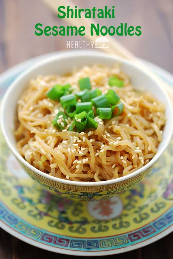 1 (7oz) bag Miracle Noodles, angel hair 1 teaspoon sesame seeds 1 tablespoon tahini (sesame paste) 1 tablespoon light soy sauce 1 teaspoon rice vinegar ⅛ teaspoon red pepper flakes 1 cup shredded cabbage 1 teaspoon sesame oil 1 large scallion, chopped