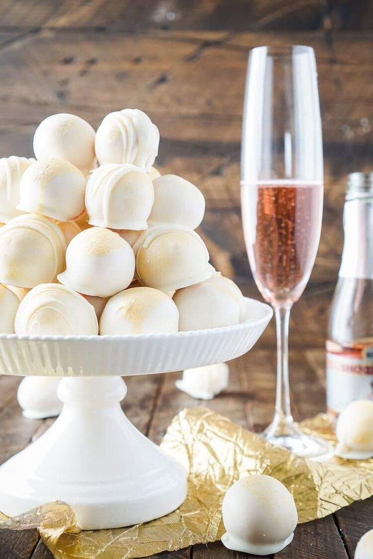 These Strawberries & Champagne Cake Balls are perfect for a New Year's Eve party, Valentine's Day, Bridal Showers and so much more!