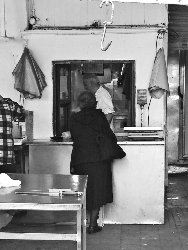 Modiano Market, Thessaloniki, Greece #modianomarket #thessaloniki #butcher #lady #blackandwhite #streetphotography #streets #travel #outdoors