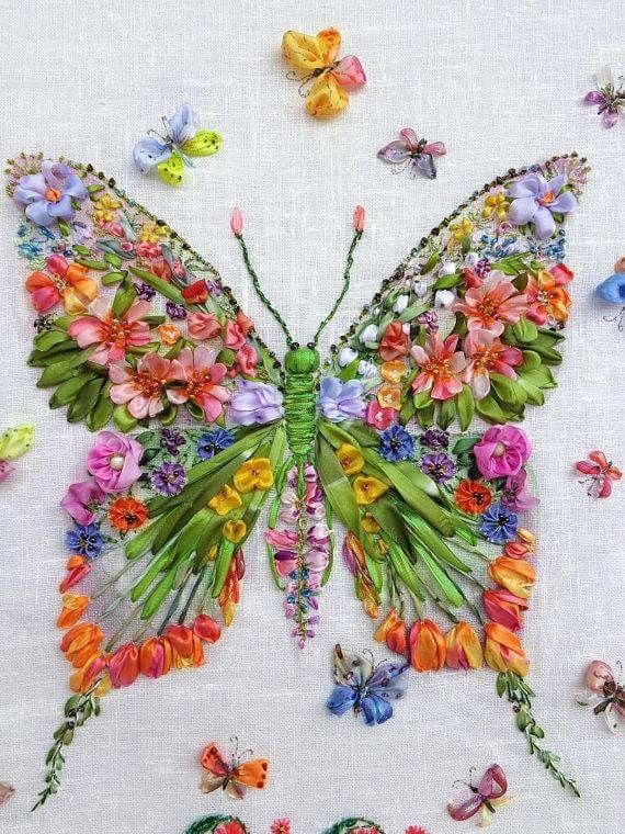 Ribbon embroidery.  It's all a bit jazzy and in-yer-face for my taste but I love the fact that it's ribbon embroidery and made of flowers.  Clever ideas