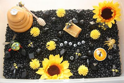 inside the table: black beans, yellow porcupine balls, jumbo sorting beads, little bees, fake sunflowers, and alphabet beads. Great for spring!