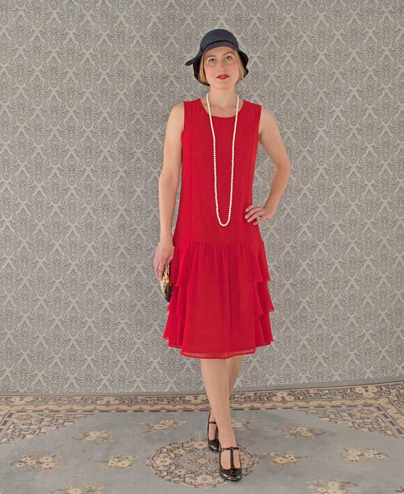 This pretty red flapper dress is made of red chiffon fabric. There are three tiers of ruffles on each side of the skirt. A small rolled hem is used for these ruffles to allow them to flow and drape freely. To emphasize the streamlined silhouette of the 1920s style we add two vertical stripes on the front of the bodice. It is a lovely fine detail. (Due to the lighting, you cannot see these lines very well, except on the 3rd picture.)  The dress is fully lined, loose fitting, drop-waist…