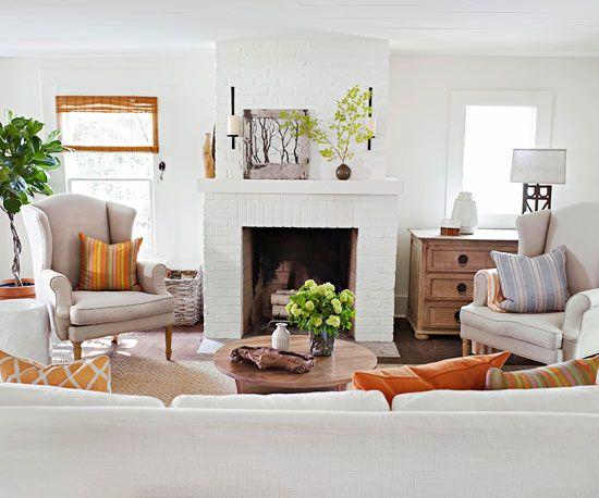 white brick fireplace + light & airy furnishings