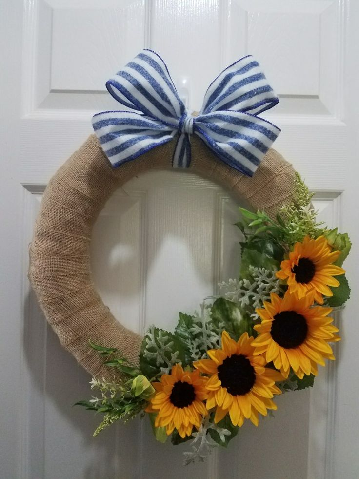 Burlap wrapped wreath with sunflowers and a blue and white bow