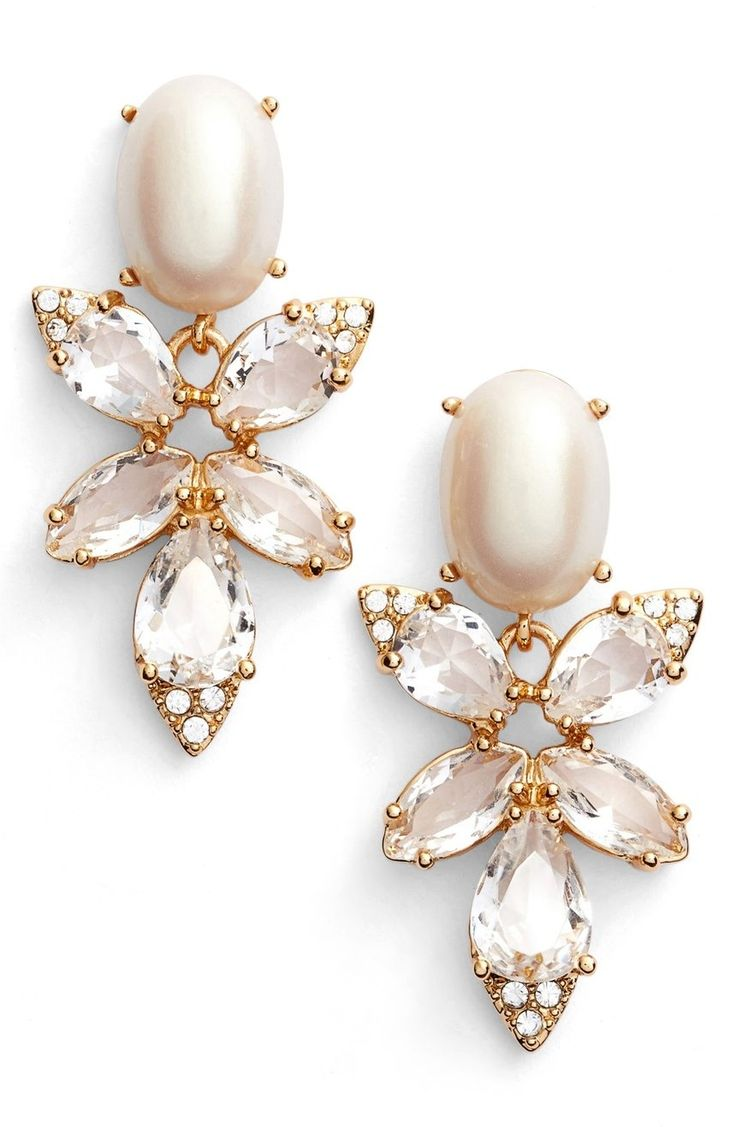 An elegant display of sparkling crystals and a luminous imitation pearl create these party-ready drop earrings by Kate Spade.