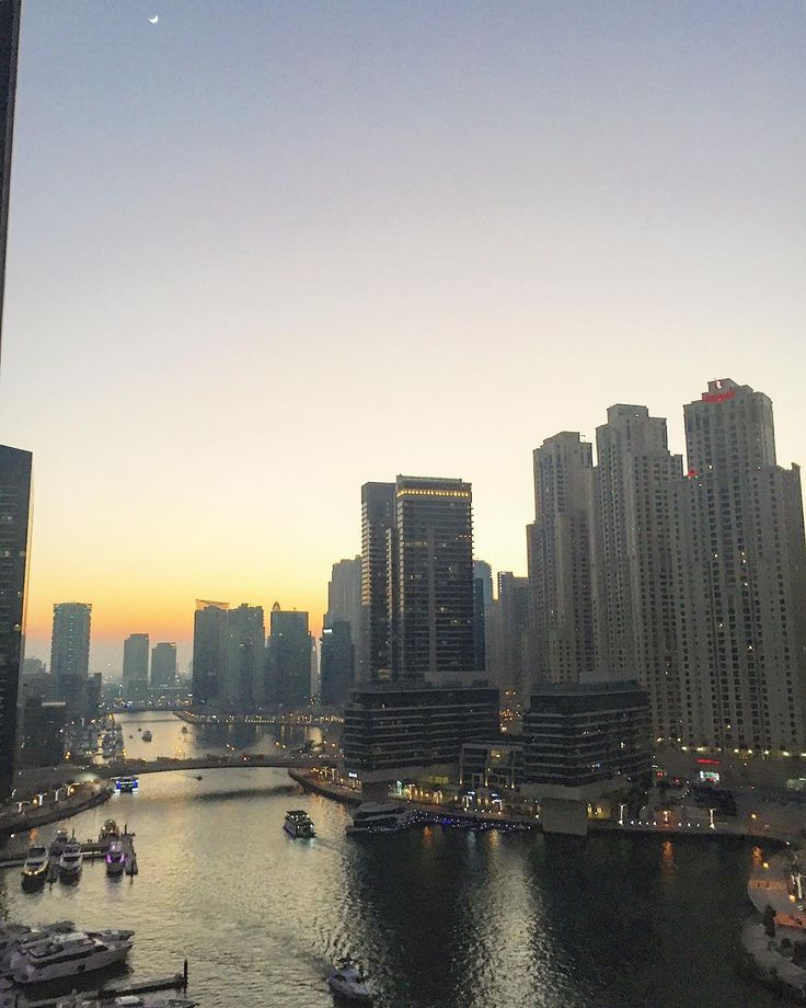 We are staying in an apartment on the 13th floor which is not very high compared to the surrounding buildings. Still the view to the #Marina is stunning!!  #visitdubai #katerinastraveldiary #dubaimarina #sunset