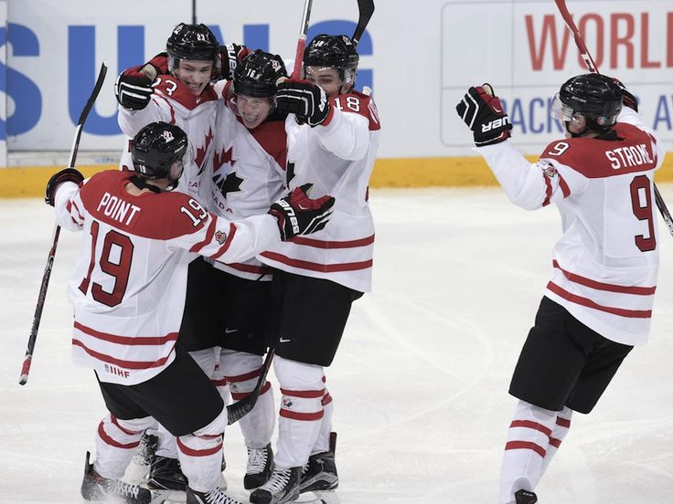 From left, Brayden Point, Travis Sanheim, Mitch Marner, Jake Virtanen and Dylan Strome of Canada, celebrate Marner's goal that tied the game 5-5.
